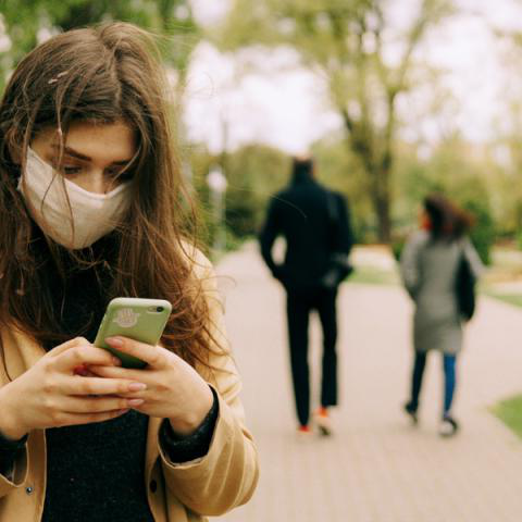 Young women wiTH. mask on cell phone, Photo by Maksim Goncharenok from Pexels