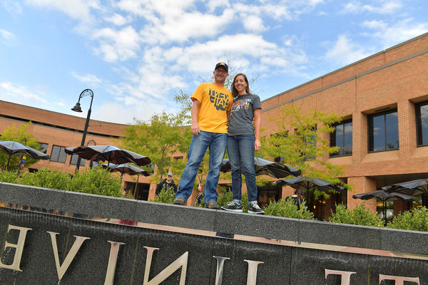 Students Standing on the Risman Plaza Fountain