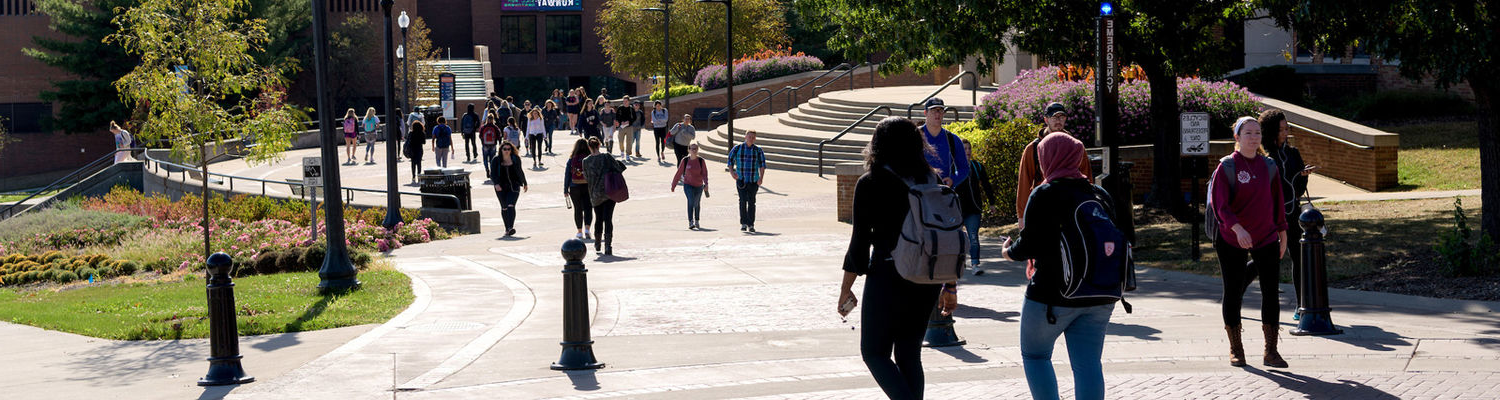Students Walking Across Campus Near the MACC