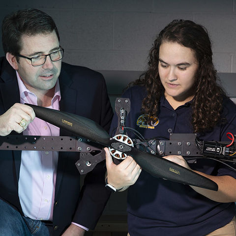 Blake Stringer, Ph.D. (right), associate professor of aerospace engineering at 肯特 State, and research assistant Kendy Edmonds study the power needs for a new larger generation of drones for a research grant funded by TH.e Army Research Laboratory.